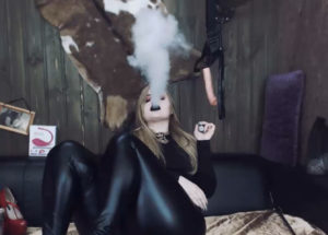 Domineering woman who smokes dressed in leather