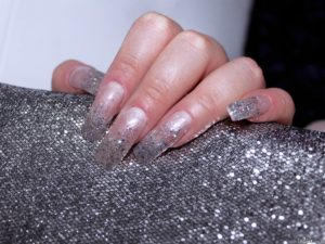 Sexually lacquered nails and glitters applied on them