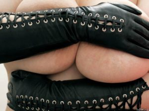Mistress with big breasts and long leather gloves