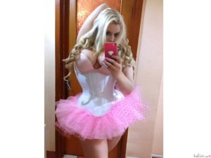Blonde girl with short pink corset dress